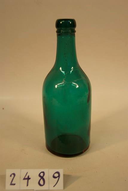 Vihreä lasipullo